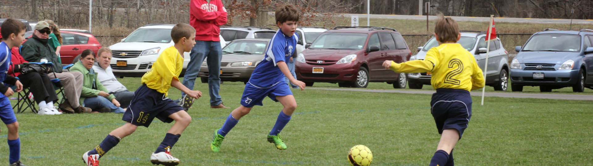 Two OSC boys players persue the ball.